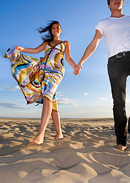 Couple walk in sand