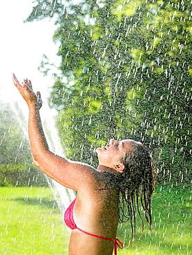 Girl under a water jet, Girl under a water jet