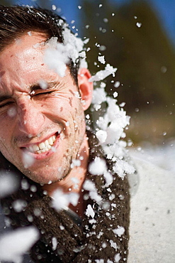 Man getting hit in face by snowball