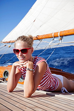 woman smiling lying on deck