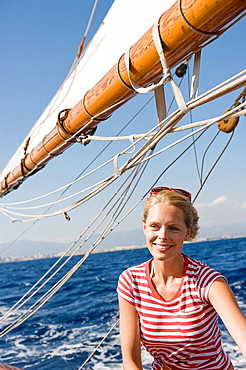 woman sitting on a sailing boat
