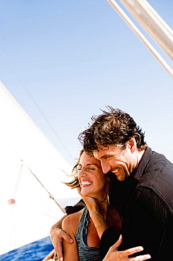 couple embracing each other on a boat