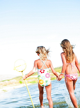 sisters playing in water at beach