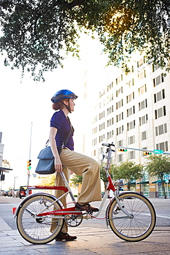 businesswoman cycling in city