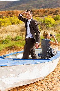 Business couple lost in desert, Couple, desert, rowingboat