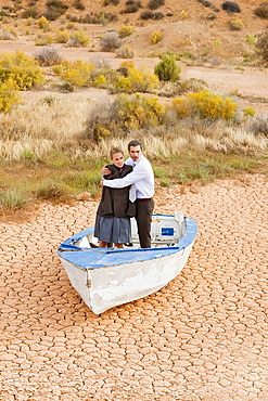 Business couple lost in desert, Couple, desert, rowingboat