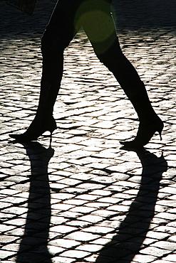 detail of woman walking in street road city town