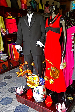 Fashion display at My My store Hoi An historic town noted for tailoring mid Vietnam