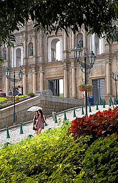 Friends walking near the Ruins of St Paul's Church, Macau, China