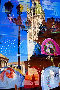 Giralda reflected in a shopwindow, Sevilla, Andalucia, Spain
