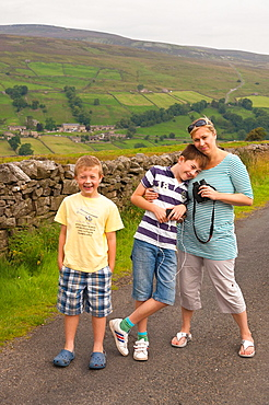 A mum with her two sons in Swaledale in North Yorkshire, England, Britain, Uk