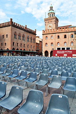 Italy, Bologna, chairs in Piazza Maggiore for the 'Cinema in Piazza', an annual movies season (June-July); Palazzo D'Accursio on the background