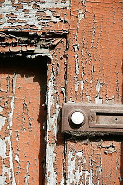 push button door bell on old brown door