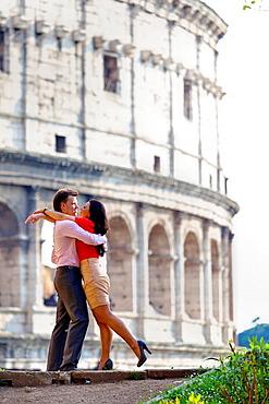 Couple at the Roman Coliseum Rome Italy