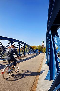 Cyclists riding at the car-free Wiwili-bridge Freiburg im Breisgau Baden Wuerttemberg Germany