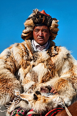 Kazakh eagle hunter on the Central Asian steppe in Bayan-Olgii in Western Mongolia