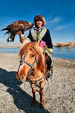 Kazakh eagle hunter and his golden eagle in the Altai Region of Bayan-Olgii in Western Mongolia