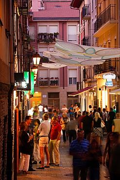 Spain, La Rioja Region, La Rioja Province, Logrono, crowds outside tapas bars on Calle Laurel street