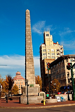Pack Square pigs with the Vance Monument and Neo-Gothic Jackson Building in Asheville, NC