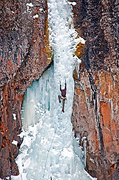 Jed Weber ice climbing a route called The Elevator Shaft which is rated WI-4 and located at the Unnamed Wall in Hyalite Canyon near the city of Bozeman in southern Montana