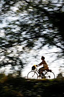 person riding fast bike on rural lane countryside