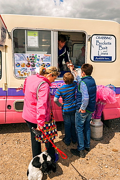 A family buying ice creams from a van at Walberswick , Suffolk , England , Britain , Uk