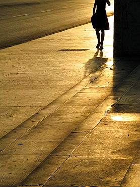 young woman walking in street road in city town