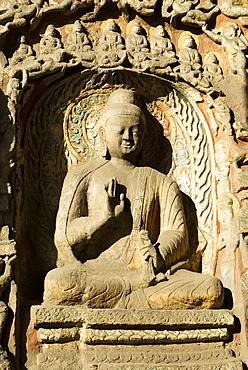 Buddha effigy at the Yungang Grottoes, Datong, Shanxi Province, China