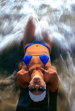 Woman laying in surf