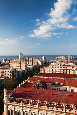 Cuba, Havana, elevated city view above Paseo de Marti towards Castillo de los Tres Santos ReImage Available For Editorial Use Only del Morro, late afternoon