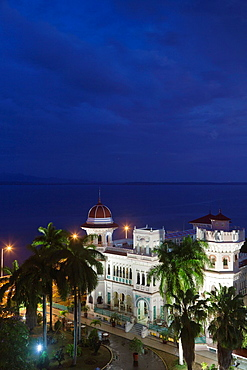 Cuba, Cienfuegos Province, Cienfuegos, Punta Gorda, Palacio de Valle, former sugar baron mansion, elevated view, dusk