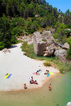 People happening the day in the beach fuvial from Quesa, Canal de Navarres, Spain, Europe