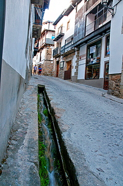 Street and canal for water, called regadera. Candelario, Salamanca province, Castilla Leon, Spain.