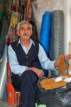 Man selling tobacco, Mardin market, Anatolia, Eastern Turkey