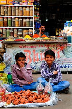 Boys selling cray oil lamp for Diwali festival