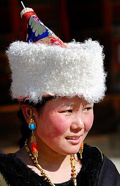 China, Gansu, Amdo, Xiahe, Monastery of Labrang Labuleng Si, Losar New Year festival, Young Tibetan lady