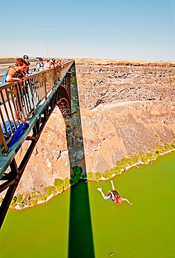 Ashly Gillis BASE jumping at the Perrine Memorial Bridge over the Snake River Canyon near the city of Twin Falls in southern Idaho