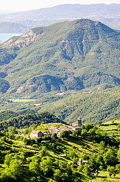 Panoramic views of Bestue village and agricultural terraces in front of Ordesa & Monte Perdido National Park, Huesca Pyrenees, Aragon, Spain