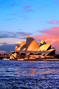 Colorful night time graphic sunset of Famous Sydney Opera House in New South Wales Australia