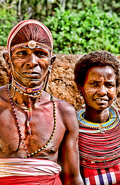 Maasai tribe people couple in costume traditional dress in jungles near hut near Kenya Africa