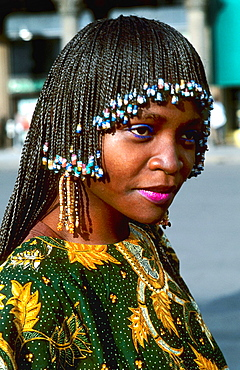 Beautiful Cameroon Africa woman in native costume with head dress and colorful costume in green gown