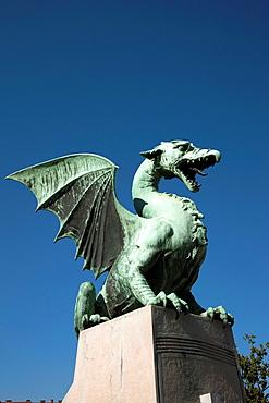 Slovenia Ljubljana Bronze dragon on the Dragon Bridgew, over Ljubljanica River.