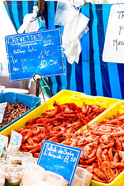 Fresh seafood, crevettes, prawns and shrimps for sale in the market at Chartres, Loire, France