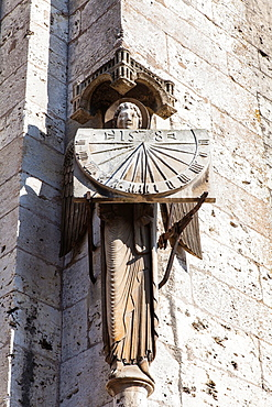 Stone sundial with religious figure on Chartres, Loire, France