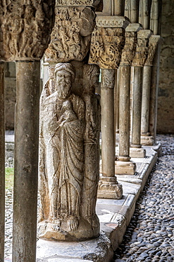 Column depicting Evangelists in western gallery of cloister of Cathedral Notre-Dame de Saint-Bertrand-de-Comminges. Hautes-Pyrenees, France.