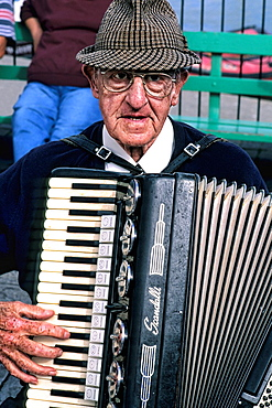 Man playing accordion in Cornwall England