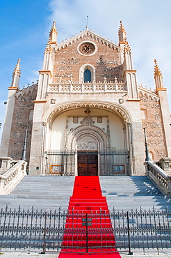 Facade of San Jeronimo El Real church with red carpet. Madrid, Spain.