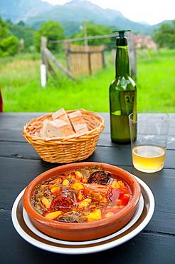 Pote asturiano serving with cider. Asturias, Spain.