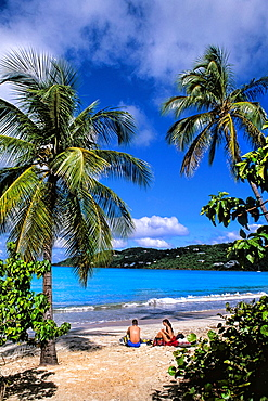 St Thomas beautiful beaches and palms at famous Magens Bay and ocean with waves and tourists