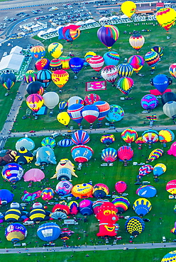 Aerial view of hot balloons preparing to lift off at Balloon FIesta Park, Albuquerque International Balloon Fiesta, Albuquerque, New Mexico USA